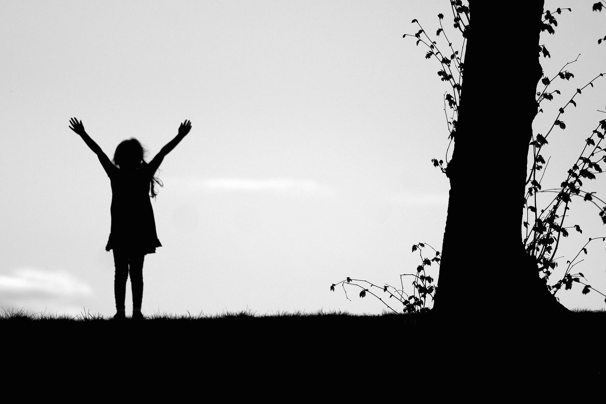 girl-arms-up-silhouette